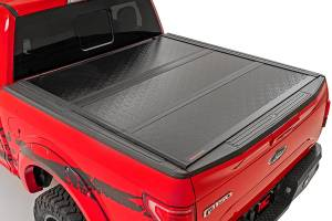 "Dodge/Jeep Ecodiesel - 2014-2018 Ram 1500 3.0 Ecodiesel - Rough Country - Dodge Hard Tri-Fold Bed Cover (09-18 Ram 1500 - 5' 5"" Bed)"
